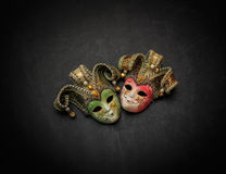 Nice gorgeous detailed view  of colorful theatrical old masks on dark grey background Stock Photography