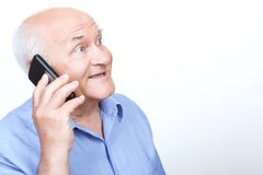 Nice grandfather talking on the mobile phone Royalty Free Stock Photography