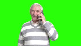 Nice grandfather talking on the mobile phone. Attractive senior male using cell phone, hromakey background stock video