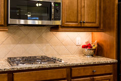 Nice Granite Countertop with Gas Range Royalty Free Stock Images