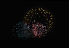Nice great fireworks in night sky. Nice gold and rose fireworks in night dark sky Royalty Free Stock Photo