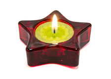 Nice green candle, inside a red star. Nice green candle, inside a red star, on a white background Stock Image