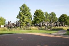Nice group bronze sculpture in Centennial Land Run Monument. Group bronze sculpture in Centennial Land Run Monument sunset, city Oklahoma USA royalty free stock image