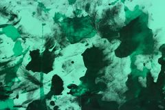 Nice grunge teal, sea-green randomly painted canvas, fabric with color paint spots and blots texture for design purposes. Beautiful shabby teal, sea-green stock photography