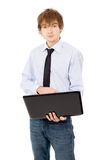 Nice guy running on a laptop, dressed in a shirt and tie Royalty Free Stock Photography