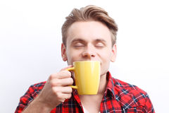 Nice guy smelling tea aroma Royalty Free Stock Photos