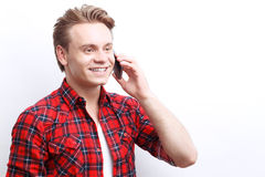 Nice guy talking on the mobile phone Royalty Free Stock Image