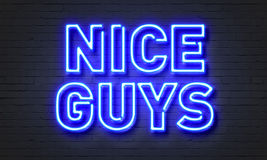 Nice guys neon sign on brick wall background. Nice guys neon sign on brick wall background Stock Image