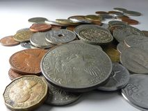 A nice handful of coins stock photography