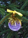 Handmade violet decoration hanging on Christmas tree stock photos