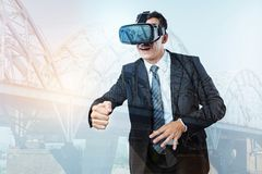 Nice handsome man being in a virtual dimension. Different world. Nice handsome pleasant man wearing 3d glasses and being in a virtual dimension while Royalty Free Stock Images