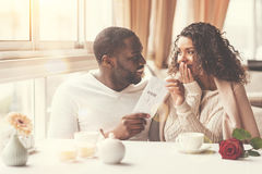 Nice handsome man having a surprise for his girlfriend Royalty Free Stock Image