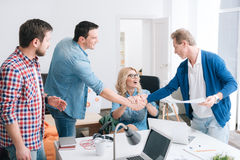 Nice handsome men shaking hands Royalty Free Stock Photo