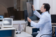 Nice handsome radiologist sitting in the chair Stock Images