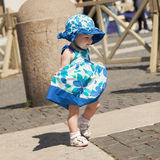 Nice happy cute baby girl walking in dress Royalty Free Stock Photography