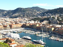 Nice harbour. Harbour in Nice, France with Alps mountains in the background Royalty Free Stock Image