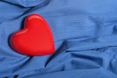 Nice Heart. A red heart on a blue background Royalty Free Stock Photo