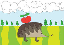 Nice hedgehog with red apple on the glade Royalty Free Stock Image