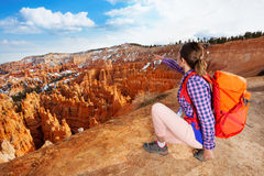 Nice hiker woman point to Bryce canyon with hand Royalty Free Stock Images