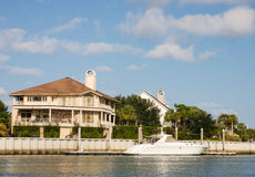 Nice Home on Channel with Small Yacht Royalty Free Stock Image