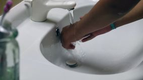 Woman washing her hands stock footage