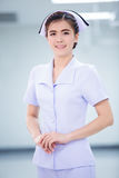 Nice and hospitality female doctor standing with hospital Stock Photo