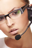 Nice hotline operator with headset. A nice and smiling hotline operator with headset Royalty Free Stock Image