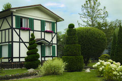 Nice house. Wooden house with nice garden Royalty Free Stock Photos
