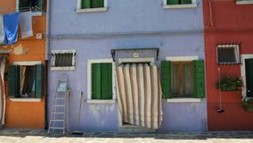 Nice house painted in blue color, famous vivid architecture on Burano island. Stock footage stock video