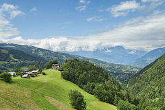 Nice houses on top of alpine hill Stock Photo