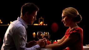Nice husband and wife having romantic dinner in restaurant, night for two stock images