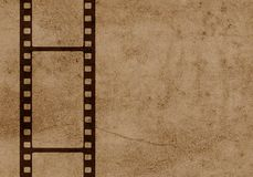 Brown 35mm film strip with old background. Nice illustration of a brown 35mm film strip with old background royalty free stock photos