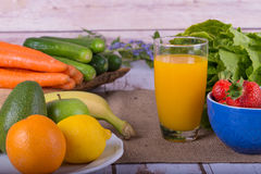 Nice image of a fruit and vegetable based juice. Stock Photos