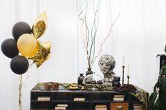Nice interior in the restaurant. With yellow and black balloons, woman`s bust and white curtains royalty free stock photo
