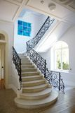 Nice interior with a stairway. In a classic style and a window in Nice, France royalty free stock photos