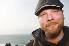 Nice Irish Man. A friendly man with a red beard and a duckbill hat on at the beach Stock Photo