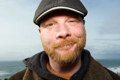 Nice Irish Man. A friendly man with a red beard and a duckbill hat on at the beach Stock Photography