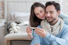 Nice joyful couple recovering from an illness royalty free stock photo