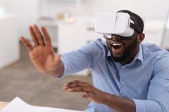 Nice joyful man being in virtual reality Stock Image