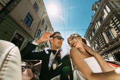 Nice just married couple in the sunny day. A Stock Images