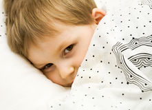 Nice kid in a bed Royalty Free Stock Photography