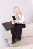 Nice kid with remote control Stock Photos