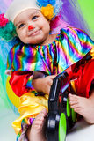 A nice kid wearing clown clothes. Stock Photos