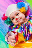 A nice kid wearing clown clothes. Stock Photo