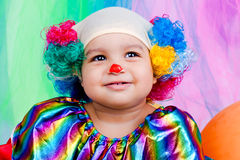 A nice kid wearing clown clothes and hair. The boy is very happy Stock Photography