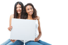 Nice ladies holding sheet of paper Stock Images