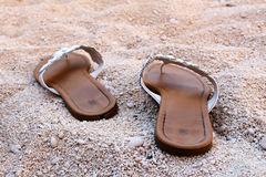 Nice ladies sandals on the sandy beach Royalty Free Stock Images
