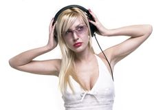 Nice lady. In white is listening music stock photo