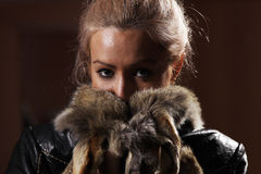 Nice lady in a fur coat Stock Photography