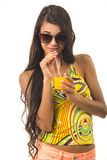 Nice lady is holding a glass in her arm. Royalty Free Stock Image
